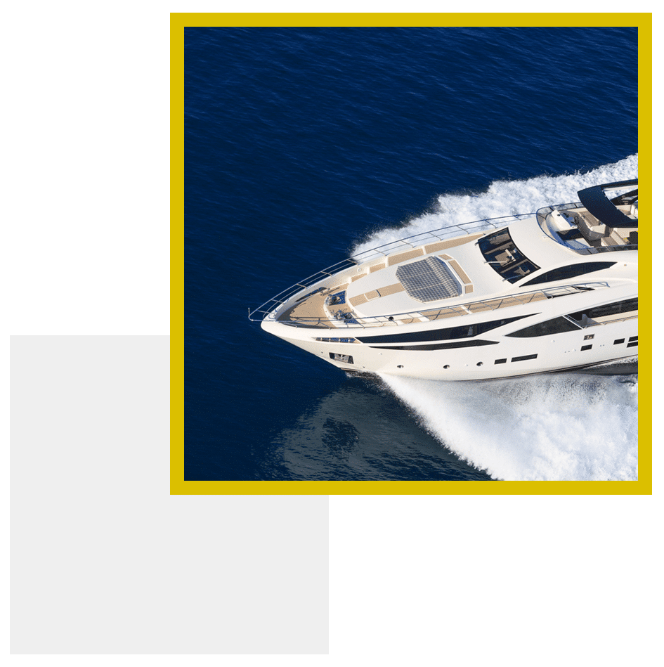 A yacht equipt with Electronic Fouling Control AKA Ultrasonic Antifouling cruising the sea.
