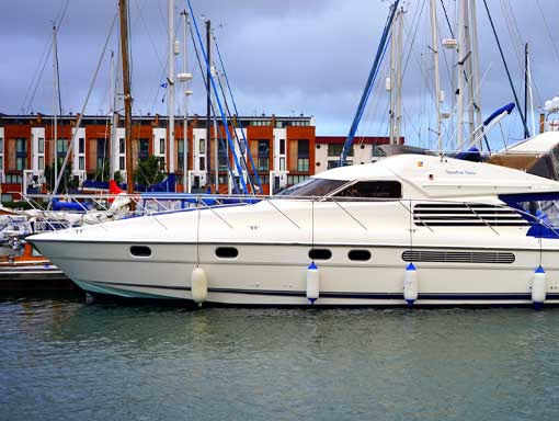 A beautiful white and blue yacht moored